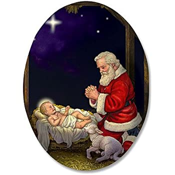 kneeling santa in manger humble adoration infant christ 3 inch oval magnet