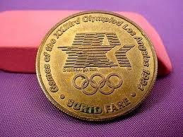 1984 Los Angeles Olympics -- Brass Transportation Tokens -- Four in all -- Handball, Judo, Field Hockey, Canoeing