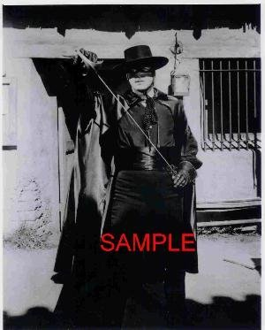 Guy Williams Zorro Photo With Hat And Mask Putting Sword Away 8x10 GW1007 (Mask Of Zorro Sword)