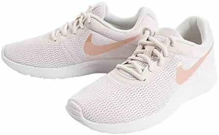 huge selection of ebcb6 b5b5b NIKE Womens Tanjun Running Shoes