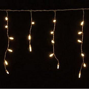 Amazon Com 70 Warm White Led Icicle Lights White Wire