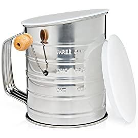 Natizo stainless steel 3-cup flour sifter - lid and bottom cover - no more mess in your kitchen 1 ✓ impress your family and friends with cakes that are finer and lighter than ever before. Get rid of annoying flour lumps, effectively mix your ingredients and increase the accuracy of your measurements to make irresistible cakes, cookies and pastry that everyone adores. ✓ eliminate flying flour in your kitchen and flour rings in your cupboards. You have better things to do than clean up flour from every corner of your kitchen (and yourself). That's why we've created a lid to stop flour flying out the top of the sifter when you're using it and a unique bottom cover to keep your cupboards clean during storage. ✓ fast and easy to use and clean. Flour, icing sugar, baking powder, cocoa and your other powdered ingredients quickly pass through the fine mesh with an easy turn of the handle thanks to the classic crank design and the 2 wire agitator. To clean up, simply wipe down the sifter and when it's dry snap on the lids. Makes sifting easier than ever.