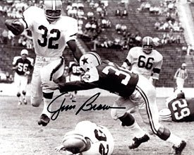- Jim Brown Autographed / Signed Breaking Tackle 8x10 Photo