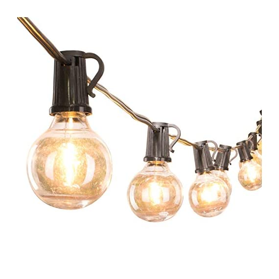 """Brightown LED G40 Outdoor String Lights 50FT Patio Lights with 51 LED Shatterproof Bulbs(1 Spare), Weatherproof Commercial Hanging Lights for Backyard Bistro Deck Party Decor, E12 Socket, 2700K, Black - SHATTERPROOF&SAFE: This led G40 bulbs made of plastic, much shatterproof than traditional glass bulb type. Low working temperature, and safe for touch. Multi-STRANDS CONNECTABLE: 6"""" lead with male plug, 12"""" spacing between bulbs, 6"""" tail with female connector. Total Length 50 Feet. Globe LED string lights can end to end connectable up to 7 strands(=350FT), feel free to customize your arrangements. ENERGY SAVING: Each LED bulb 0.4w (= 5W Tradition Bulbs), much lower wattage will save more energy for you, but the lifespan is 10-20 times of the traditional tungsten bulb. Candelabra (E12) socket base. - patio, outdoor-lights, outdoor-decor - 41qhc%2Bl3nlL. SS570  -"""