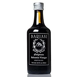 Bariani Organic Balsamic Vinegar of California 16.9 fl.oz - Natural and Semi-Sweet 1 ✔️ The Bariani Balsamic Vinegar amplifies the original, natural flavors of Trebbiano grapes through our bespoke aging techniques. Features a perfect balance between sweetness & acidity. ✔️ HEALTHY INGREDIENT: Using flavored balsamic vinegar in balsamic vinaigrette dressing, balsamic glaze, and balsamic reduction is a great way to add high flavor with low calories. ✔️ HIGHEST QUALITY: Organic, non-GMO, authentic California Balsamic Vinegar is made with concentrated and Trebbiano grapes must and organic wine vinegar. Real balsamic is a barrel-aged product.