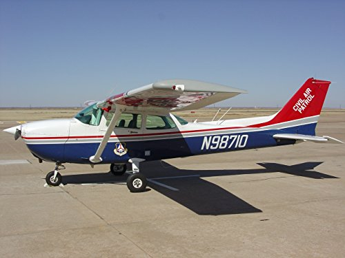 A Civil Air Patrol Cessna 172 aircraft sits next to the runway at the regional airport just north of - Regional Airport