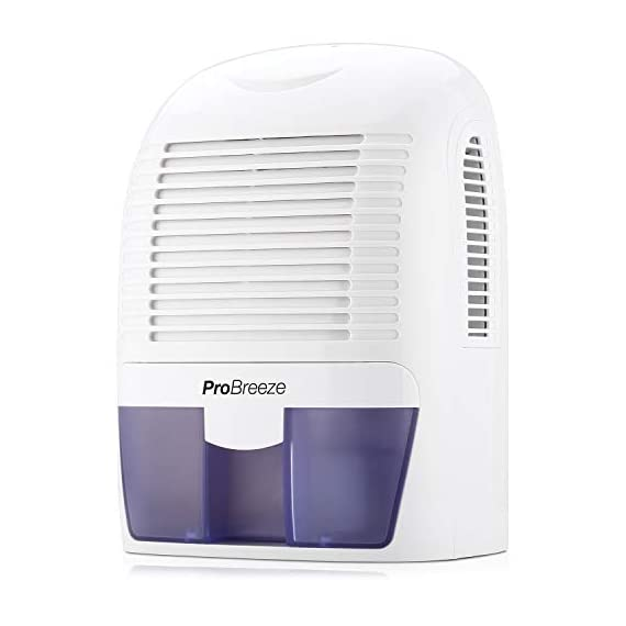 Pro Breeze Electric Mini Dehumidifier, 2200 Cubic Feet (250 sq ft), Compact and Portable for High Humidity in Home… 1 Small & Compact: Lightweight, compact and portable. Capable of removing up to 18 ounces of water per day with a 52-ounce water tank capacity. Ideal for rooms up to 2200 cubic feet (250 sq ft) Auto Shut-Off: When full the dehumidifier will automatically shut off and the LED light will turn-on indicating the water tank needs draining. Simply empty the water tank and place it back into the dehumidifier Ultra-Quiet & Efficient: Built-in Thermo-Electric Cooling Technology (Peltier) operates without a compressor meaning whisper quiet operation in bedrooms, bathrooms and offices