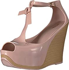 Make peace with yourself in this chic platform wedge. Synthetic upper. T-strap design with a tassel detail and an adjustable buckle closure. Peep-toe silhouette with a platform wedge heel.  Patterned heel. Synthetic lining and insole. Synthe...
