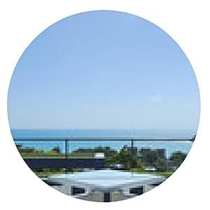 alfombrilla de ratón salón terraza con sillones de mimbre blancas y vistas al mar en una Luxu - ronda - 20cm