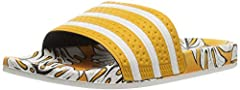 Originally designed as shower slides for soccer players in the '70s, the Adilette has evolved into versatile sandals for sporty leisure. These slides show off a tropical vibe with a pineapple print designed in collaboration with Brazilian str...