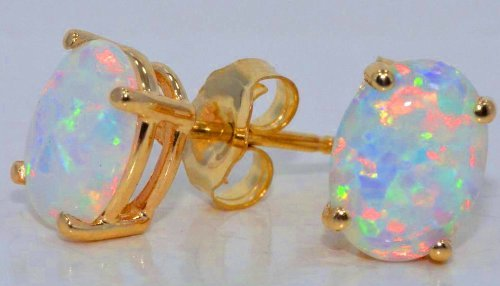 (8x6mm Simulated Opal Oval Stud Earrings 14Kt Yellow Gold & Sterling Silver)