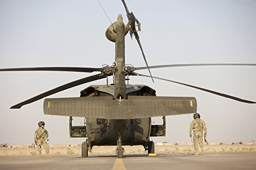 (Posterazzi Crew Chiefs stand beside their UH-60L Black Hawk helicopter Poster Print (34 x 23))