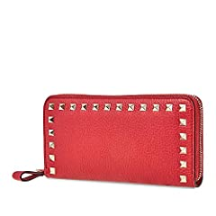 Valentino Rockstud long wallet crafted in pebbled leather with metal hardware and fittings. This wallet fetaures credit card slots, 1 center zip pocket, note compartment, and zip around closure. DiMen'sions: W: 20cm x H: 10cm x D: 3cm.
