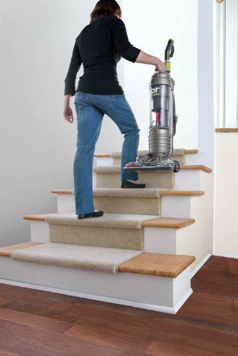 Hoover WindTunnel Air Bagless Upright Corded Lightweight Vacuum Cleaner - taking up stairs