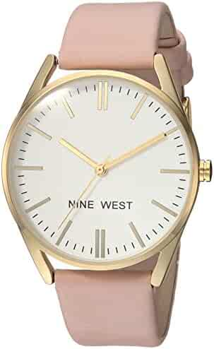 Nine West Women's NW/1994WTPK Gold-Tone and Pastel Pink Strap Watch