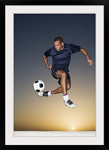 GreatBIGCanvas ''Soccer Player Kicking Ball In Mid-Air '' Photographic Print with black Frame, 24'' X 36'''' by greatBIGcanvas