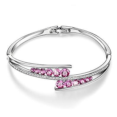 Très beau bracelet en argent avec pierre rose de swarovski de plusieurs tailles.