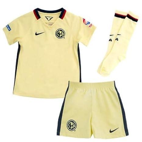 3412b0fe057 Nike Kids Club America 15 16 Home Kit Lemon Chiffon Armory Navy Jersey -