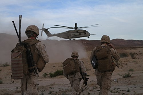 3rd Battalion 7th Marine Regiment - Home Comforts LAMINATED POSTER Marines with Company L, 3rd Battalion, 7th Marine Regiment, make their way to a CH-53E Sea Stallion