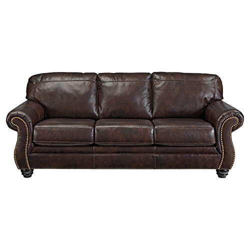 Ashley Furniture Signature Design - Bristan Traditional Style Faux Leather  Sofa with Nailhead Trim - Walnut Brown