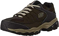 Smooth leather, synthetic and mesh fabric upper in a sporty training sneaker with perforated details, stitching and overlay accents. Padded collar and tongue, fabric lining, Memory Foam insole, Articu-Lyte rubber sole and a flexible, high-tra...