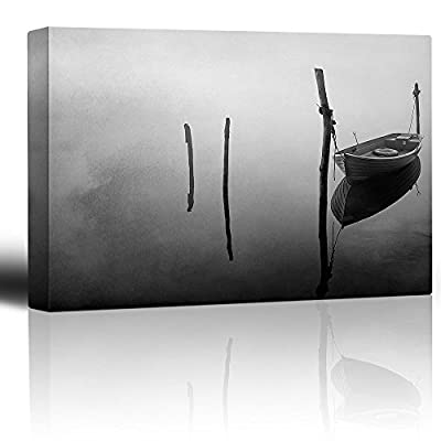 Black and White Photo of a Lone Boat Floating on a Lake - Canvas Art Home Art - 12x18 inches