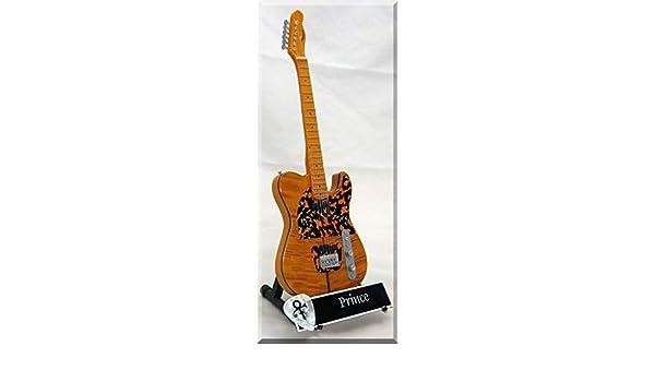 PRINCE Guitarra miniatura con púa de guitarra HOHNER: Amazon.es ...