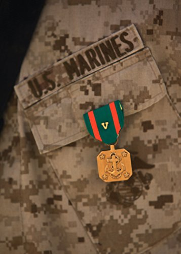 Marine Corps Achievement Medal (A Navy and Marine Corps Achievement Medal with Combat Distinguishing Device hangs from the chest of)