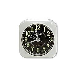 Traveler Mini Alarm Clock, Quartz Movement, Simple Modern Design, 2.5 in Diameter. Mute (non-ticking) Clock Hands. Built-in Light Bulb