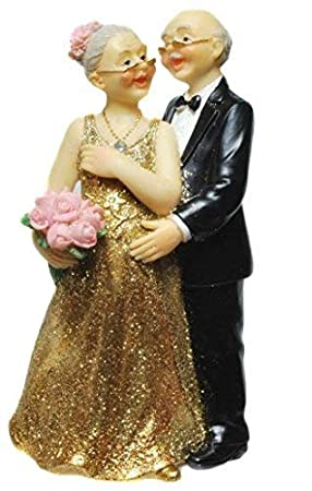 Amazon De Goldpaar Mit Blumenstrauss In Der Hand Goldhochzeitspaar