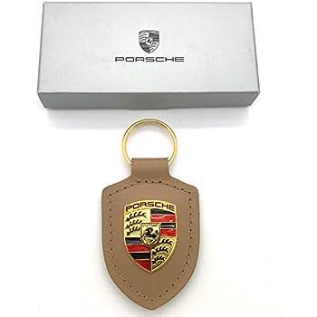 Amazon.com: Porsche llavero con escudo, gris: Automotive