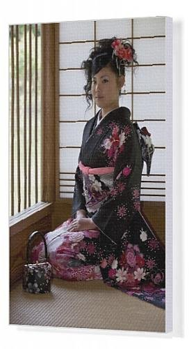 Canvas Print of A 20-year old Japanese girl wearing spring furisode kimono with long sleeves to from Robert Harding