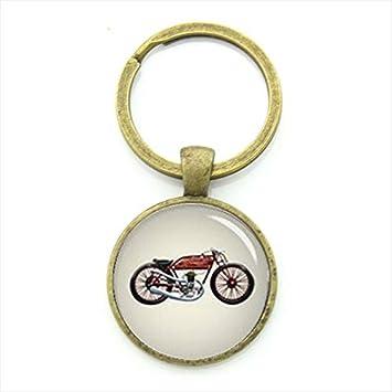 YPT KC353 - Llavero, diseño de ciclista: Amazon.es: Oficina ...
