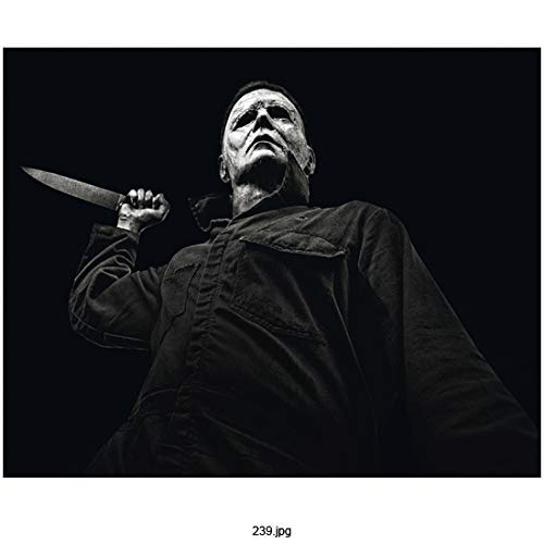 Nick Castle 8 inch by 10 Inch Photograph Halloween (2018) Pic Taken from Below Holding Knife Up Ready to Strike w/Black Background kn]()