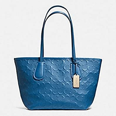 15d03d291a Amazon.com  Coach Logo Embossed Leather 24 Taxi Zip Tote Li navy  Shoes