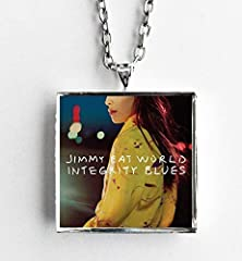 """This is a necklace featuring album art of the """"Integrity Blues"""" record by Jimmy Eat World sealed in a silvertone metal setting. The album cover pendant is 1"""" and on a 20"""" long silvertone neck chain. The necklace is individually handcrafted by..."""