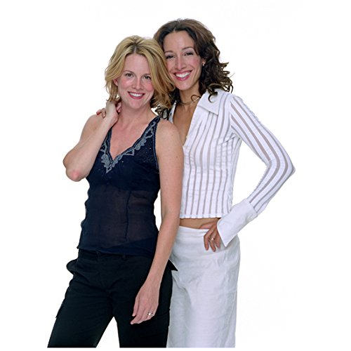 The L Word Laurel Holloman as Tina Kennard in Black Sheer Tank Top and Jennifer Beals as Bette Porter in White Pantsuit Smiling 8 x 10 inch photo