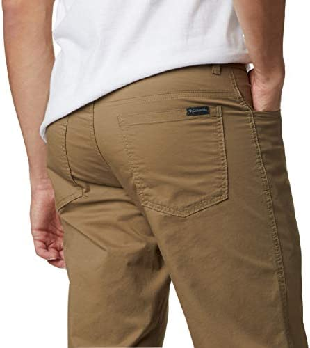 41tey2G9mHL. AC Columbia Men's Rapid Rivers Pant    ImportedButton closureMachine WashOMNI-SHADE: Be safe and protected. Omni-Shade blocks UVA and UVB rays to help prevent sunburns and long-term skin damage. The tight weave construction with UV absorbent yarns block the full spectrum of harmful UV rays.HANDY FEATURES: This men's stretch pant features two side pockets to keep your smaller items secure.ADJUSTABLE FEATURES: This men's stretch pant features a partial elastic waist and gusset detail for the ultimate comfortability.