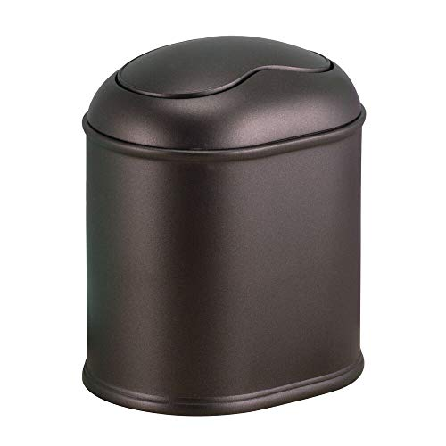 mDesign Modern Plastic Mini Wastebasket Trash Can Dispenser with Swing Lid for Bathroom Vanity Countertop or Tabletop - Dispose of Cotton Rounds, Makeup Sponges, Tissues - Bronze
