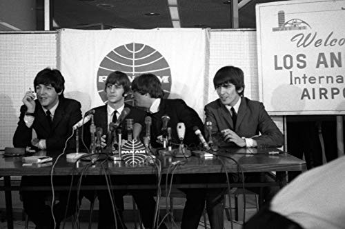 Paul McCartney and John Lennon and Ringo Starr and George Harrison in The Beatles at Lax Airport 1960'S Press Conference 24x18 - John Lennon Airport