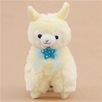 Lindo muñeco de peluche alpaca amarilla lazo estrella azul de Japón