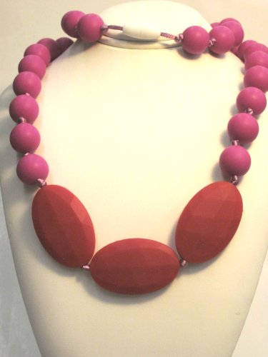 Chewable Teething Necklace for Teething Babies or Nursing Moms. Strand of 14mm Fuchsia Beads with 3 Faceted Bright Red Oval Beads in Center. Cord Is Knotted Between Each Beaded for Added Safety. Soft Silicone Food Safe Beads. BPA Free Non Toxic. Gift Box Included for Easy Gift Giving