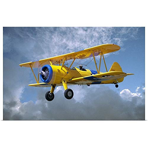GREATBIGCANVAS Poster Print Entitled Yellow Stearman 5YP bi-Plane Flying in Cloudy Sky by 18