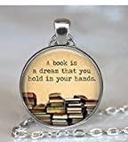 Round 'A book is a dream you can hold in your hands' quote glass dome pendant necklace