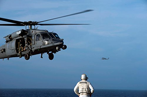 Posterazzi Poster Print Collection Sailor Watches an Air Force HH-60G Pave Hawk Helicopter Prepare to Land Stocktrek Images, (17 x 11), Multicolored