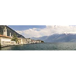Buildings at the waterfront with snowcapped mountain in the background Gargnano Monte Baldo Lake Garda Lombardy Italy Poster Print (36 x 12)