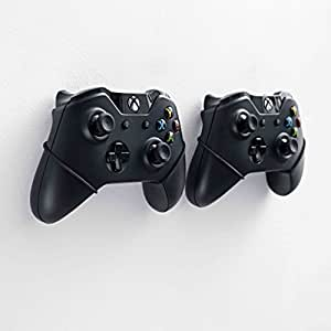 Hang your controllers cool on the wall. Upgrade your gaming station. FLOATING GRIP wall mount for Xbox controllers. Vertical rope wall mounts (Black), Patent pending and proprietary design.