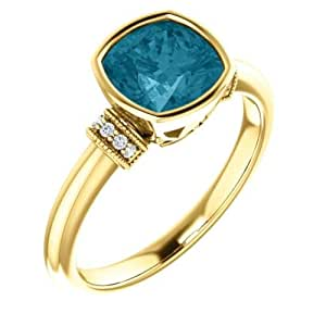 a840e79dcf4c Anillo de oro amarillo de 14 quilates con topacio azul de Londres y  diamante de 0