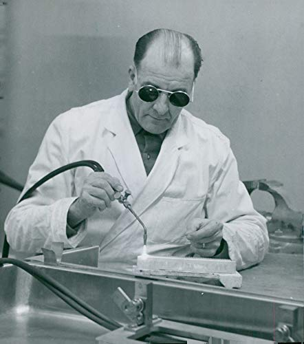 Vintage photo of Robertsfors. Foreman Emil Koskila welds a platinum tile