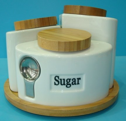 Ceramic Tea Coffee And Sugar Storage Jars On Revolving Wooden Base